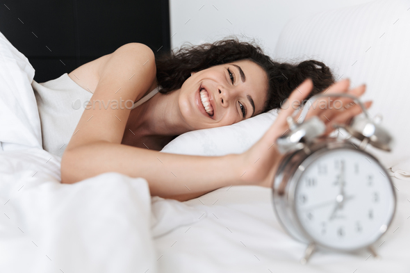 Portrait of beautiful young woman sleeping in bedroom at home, a - Stock Photo - Images