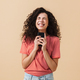 Portrait of a cheerful young girl with curly hair - PhotoDune Item for Sale