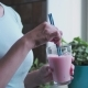 A Girl Is Drinking a Milkshake, Looking Out the Window - VideoHive Item for Sale