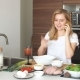 Portrait of Happy Female Wife in White T-shirt Cooking Dinner at Kitchen - VideoHive Item for Sale