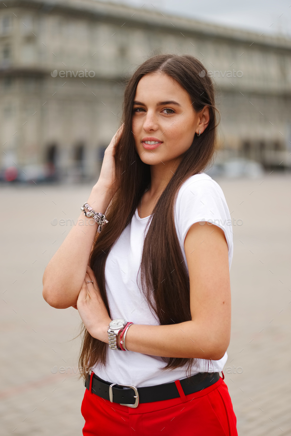 portrait of beautiful brunette with long hair - Stock Photo - Images