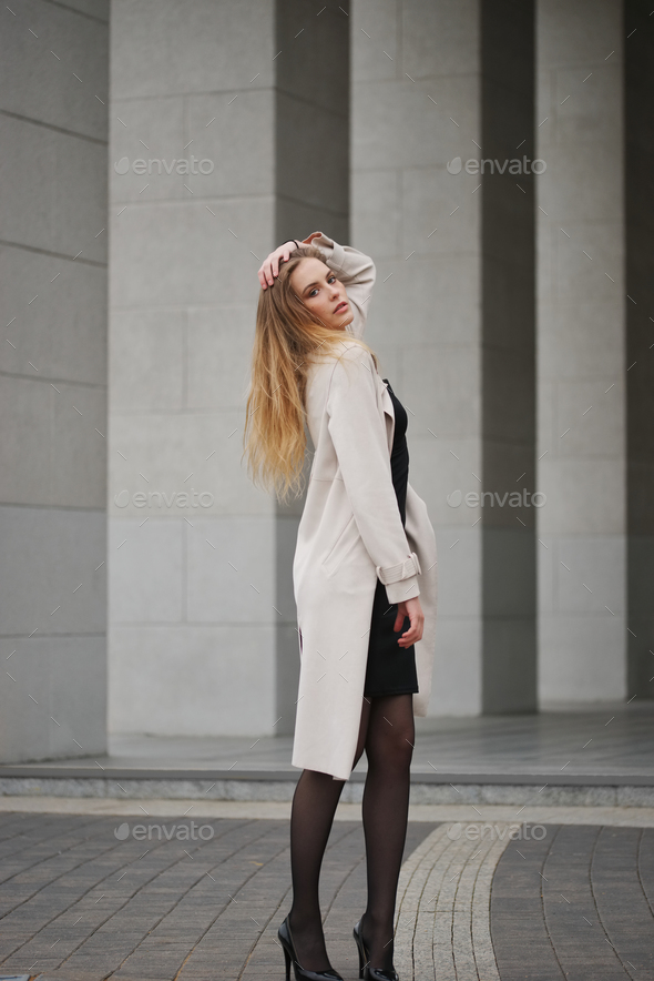 beautiful blonde girl in the street - Stock Photo - Images