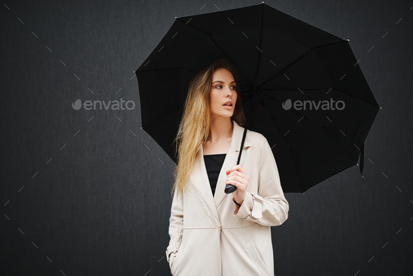 beautiful blonde girl with umbrella - Stock Photo - Images