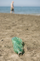 Plastic bottle left on a sandy beach. - PhotoDune Item for Sale
