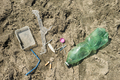 Plastic garbage left on a sandy beach. - PhotoDune Item for Sale