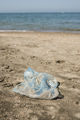 Plastic bag on a sandy beach. - PhotoDune Item for Sale
