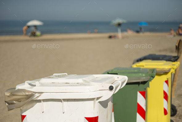 Garbage color coded bins on beach - Stock Photo - Images