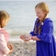 Girls Sisters Play Stones on the Beach - VideoHive Item for Sale