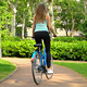 A Girl Rides a Bicycle in the Park - VideoHive Item for Sale