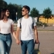 Happy Young Couple Goes with Luggage Near the Airport or Railway Station - VideoHive Item for Sale