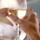 a Couple of Toast with a White Glass of Wine in the Restaurant - VideoHive Item for Sale