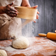 Woman hands sifting flour - PhotoDune Item for Sale