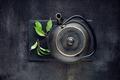Green tea leaf with black teapot - PhotoDune Item for Sale