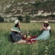 Two Girls Have Picnic in the Amazing Place with Mountains , They Are Singing at the Guitar and - VideoHive Item for Sale