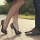 Young Couple Stand at City and Kiss Each Other Woman Up Her Toe with Pleasure - VideoHive Item for Sale