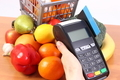 Payment terminal with credit card and fruits and vegetables, cashless paying for shopping concept - PhotoDune Item for Sale