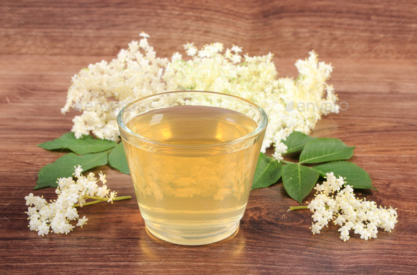 Fresh healthy juice and elderberry flowers on rustic board - Stock Photo - Images