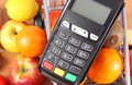 Payment terminal with fruits and vegetables, cashless paying for shopping concept - PhotoDune Item for Sale