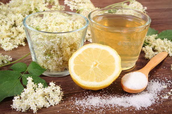 Flowers and juice of elderberry, ingredients for preparing healthy beverage - Stock Photo - Images