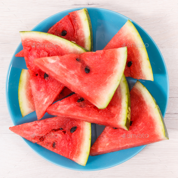 Slice of watermelon on blue plate, concept of healthy delicious dessert - Stock Photo - Images