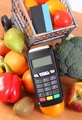 Payment terminal with contactless credit card, fruits and vegetables, cashless paying concept - PhotoDune Item for Sale