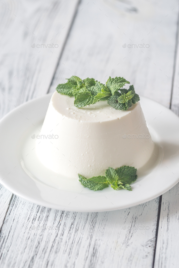Ricotta decorated with fresh mint on the white plate - Stock Photo - Images