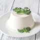 Ricotta decorated with fresh mint on the white plate - PhotoDune Item for Sale