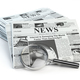 News. Loupe with  periodic ho news newspapers isolated on white. - PhotoDune Item for Sale