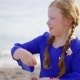 Baby Overweight Girl in Blue Dress Playing with Stones on the Beach - VideoHive Item for Sale