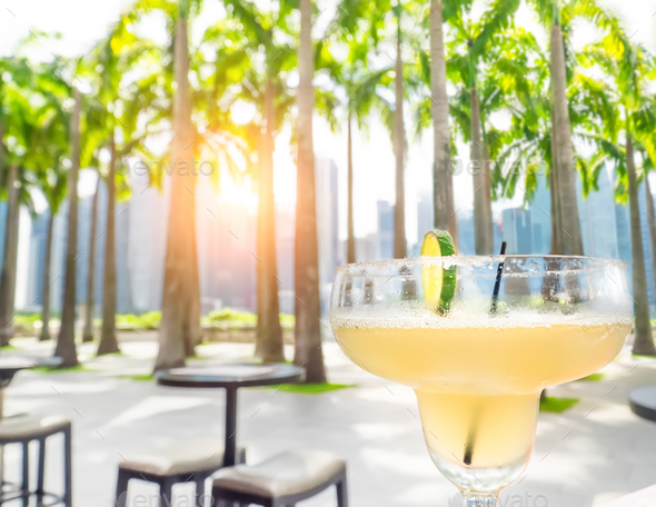 Drinking margarita cocktail in Singapore outdoors cafe - Stock Photo - Images