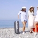 Group of Beautiful Female Tourist Standing on a Beach with a Luggage. - VideoHive Item for Sale