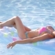 Beautiful Woman Is Relaxing on a Floating Mattress in the Pool Under Hot Sun. - VideoHive Item for Sale