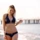 Lovely Blonde Model Is Walking Along the Beach in a Black Bikini. - VideoHive Item for Sale