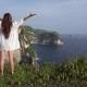 Woman Raise Hands Standing on Cliff Near Ocean - VideoHive Item for Sale
