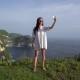 Woman Making Selfie on Kelingking Beach Background at Nusa Penida Island - VideoHive Item for Sale