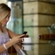 Portrait of a Charming Blonde Woman Texting with Friends and Drinking Coffee in Hotel Cafe. - VideoHive Item for Sale