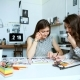 Young Female Architects Discussing with Blueprint in Office - VideoHive Item for Sale