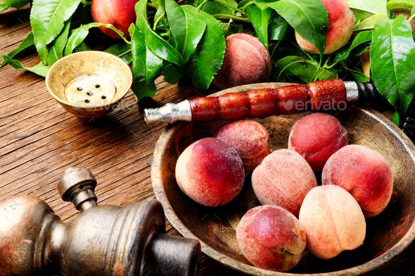 Oriental hookah shisha with peach - Stock Photo - Images