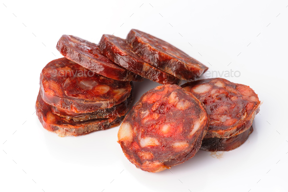 Iberian sausage cut isolated on white - Stock Photo - Images