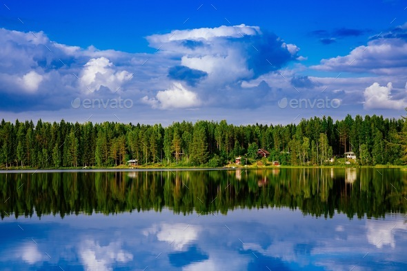 Summer cottage or log cabin by the blue lake in rural Finland. - Stock Photo - Images