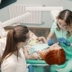 Woman Dentist Takes Patient To Dental Clinic - VideoHive Item for Sale