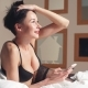 Luxury Brunette Model with Natural Big Boobs in Bra Laying on the Bed Looking at Smartphone - VideoHive Item for Sale