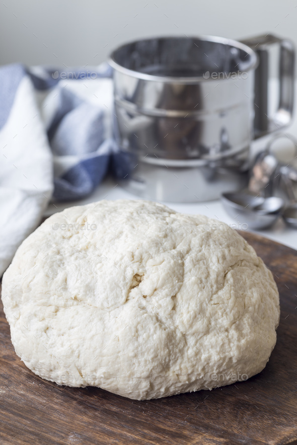 Raw cottage cheese dough on wooden board, vertical. Making savou - Stock Photo - Images