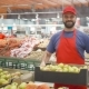 Happy Supermarket Clerk Filling Up Box with Pears in Vegetable Department - VideoHive Item for Sale