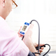 Man read measurement result from digital blood pressure monitor - PhotoDune Item for Sale