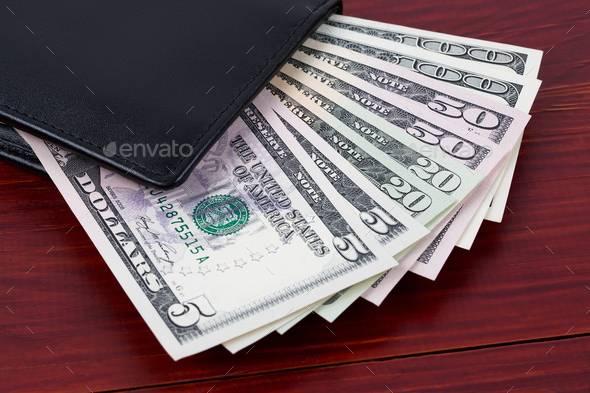 Black wallet with American dollars  - Stock Photo - Images
