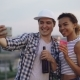 Young People Friends with Expressive Faces Are Taking Selfie with Smartphone on Rooftop - VideoHive Item for Sale