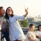 Pretty Young Ladies Are Taking Selfie with Bottles Using Smartphone During Party on Roof While Their - VideoHive Item for Sale