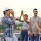 Handsome Young Man in Modern Cap Is Dancing with Friends at Rooftop Party - VideoHive Item for Sale