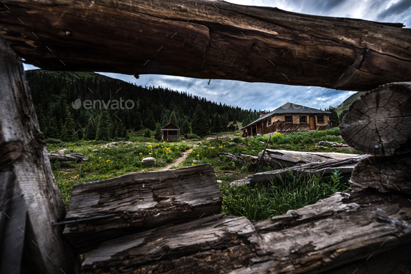 Animas Forks seen through log building remains - Stock Photo - Images